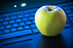 Apple on keyboard Royalty Free Stock Images