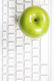 Apple on keyboard Stock Photo