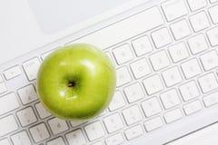 Apple on keyboard stock image