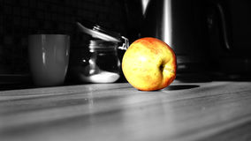 Apple. In kitchen.  with black and white royalty free stock image