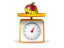 Apple on kitchen food scale Stock Images