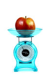 Apple on a kitchen scale - diet concept Stock Images