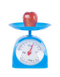 Apple on kitchen scale isolated on white background. With clipping path Stock Photos