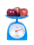 Apple on kitchen scale isolated on white background. With clipping path Royalty Free Stock Photos