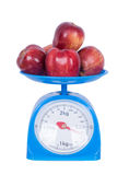 Apple on kitchen scale isolated on white background. With clipping path Royalty Free Stock Photo