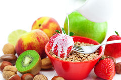 Apple, kiwi, fork, milk,nuts and wheat Stock Photography