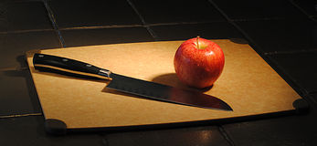 Apple and Knife Stock Photography