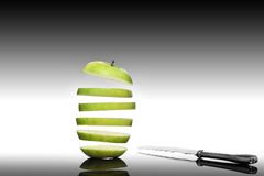 Apple with knife Stock Photos