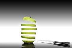 Apple with knife. Sliced apple with knife cut Stock Photos