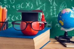 Apple Knowledge Symbol and Pencil Books on the desk with board b Stock Image