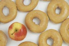 Apple kontra Donuts Royaltyfria Foton