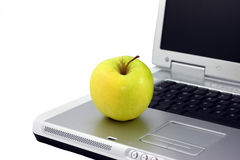 Apple On A Lap Top Computer Stock Photos