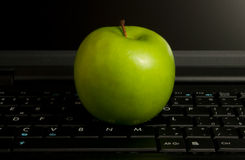 Apple on a laptop Royalty Free Stock Image