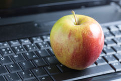 Apple on laptop Royalty Free Stock Photography
