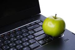 Apple on laptop keyboard Royalty Free Stock Image