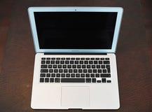 Apple-Laptop lokalisiert Lizenzfreies Stockbild