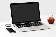 Apple with laptop and smarphone Royalty Free Stock Photography