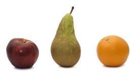 Apple, laranja e pera Imagem de Stock