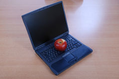 Apple lays on the keyboard laptop Stock Image