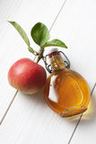 Apple and leaves glas bottle filled with apple cider vinegar Stock Photography