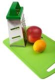 Apple, lemon and grater Stock Image