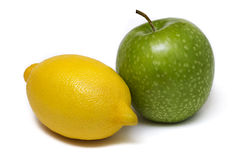 Apple and lemon isolated on white background royalty free stock photography