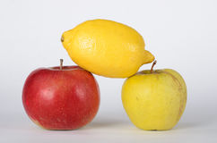 Apple and lemon. Red and green apples on white background Royalty Free Stock Image