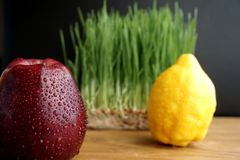 Apple, lemon and sprouted wheat Royalty Free Stock Photos