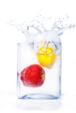 Apple and lemon in water and splashes Stock Photos