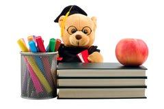 Apple, libros, etiquetas de plástico y oso de peluche Imagen de archivo libre de regalías