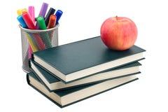 Apple, libros y etiquetas de plástico Imagenes de archivo