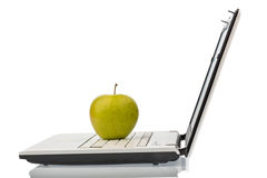 Apple lies on a keyboard Royalty Free Stock Photography