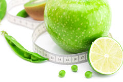 Apple,lime,peas,kiwi and measure tape Royalty Free Stock Photo