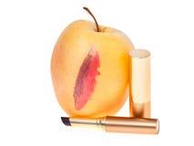 Apple with lipsticks stock photos