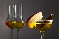 Apple liquor with cinnamon Royalty Free Stock Photo