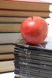 Apple, livro e Cd Fotografia de Stock Royalty Free