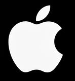 Apple Logo. Apple. Inc logo in illuminated white on black background. Apple is an American multinational corporation is the maker Mac computers, iPod, iTune