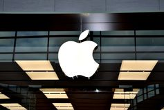 Apple logo. In building entrance Royalty Free Stock Photos