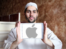 Apple logo. Apple company logo and vector on samsung tablet holded by arab muslim man Royalty Free Stock Images
