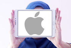Apple logo. Apple company logo and vector on samsung tablet holded by arab muslim woman Royalty Free Stock Images