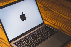 Apple logo on laptop screen. Dallas, Texas/ United States - 06/7/2018: Photograph of the Apple logo on computer screen Royalty Free Stock Image