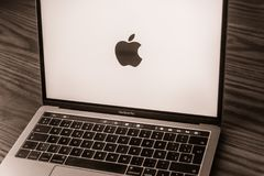 Apple logo on laptop screen. Dallas, Texas/ United States - 06/7/2018: Photograph of the Apple logo on computer screen Royalty Free Stock Photo