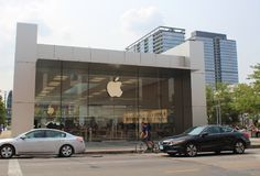 Apple Logo on Apple Lincoln Park Store, Chicago. The Apple logo is seen on the facade of the Apple Lincoln Park Store in Chicago, Illinois Royalty Free Stock Images