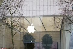 Apple logo outside a store. Brussels, Belgium - December 9, 2017: Apple store. Apple is an American multinational technology company headquartered in Cupertino Stock Photography