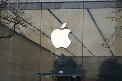 Apple logo outside a store. Brussels, Belgium - December 9, 2017: Apple store. Apple is an American multinational technology company headquartered in Cupertino Stock Photos