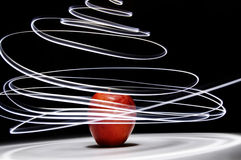 Apple with Long Exposure Light Royalty Free Stock Image