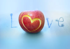 Apple love. Love shape on an apple stock images