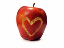 Apple love. Apple with heart carved in stock images