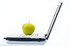 Apple lying on a keyboard Stock Photo