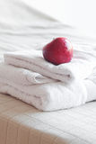Apple lying on towels Stock Photos